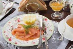 Smoked salmon, tea, orange marmalade and toast