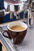 Cup of espresso on espresso machine