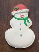 Snowman biscuit on wooden background