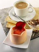 Small fancy cake, cup of coffee and sugar crystals