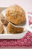 Quark dumplings with buttered breadcrumbs in roasting dish & on spoon
