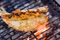 Butterflied king prawn on a barbecue