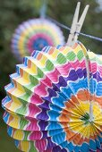 Coloured Chinese lanterns on washing line (garden party decorations)