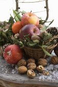 Rustic Christmas decoration with apples, nuts and cones