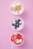 Strawberry yoghurt, blueberry yoghurt & yoghurt with cereal