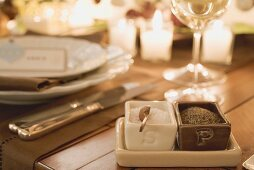 Salt and pepper beside place-setting on Christmas table
