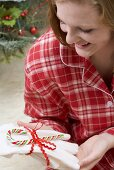 Woman pleased with Christmas gift (gloves)