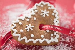 Gingerbread heart in front of red boot