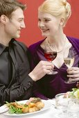 Elegant couple raising glasses of wine