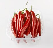 Red chillies in plastic tray