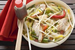 Spicy noodle soup with chicken, vegetables & soy sauce (Asia)