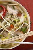 Spicy noodle soup with chicken to take away (Asia)