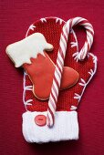 Boot biscuit and candy cane on woollen mitten