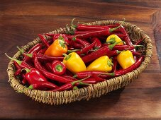 Fresh chillies and small peppers in basket