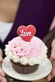 Woman holding cupcake for Valentine's Day