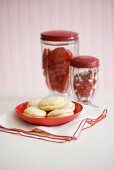 Cream-filled sandwich cookies, two jars of sweets