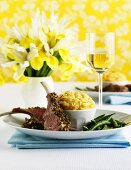Lamb chops with cheese soufflé and beans
