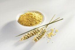 Bulgur in small dish, ears of wheat ears beside it