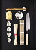 Asian noodles and kitchen utensils