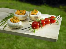 Giant mushrooms filled with Liptau cheese and tomato kebabs for the barbeque