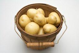 Potatoes in woodchip basket