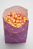 Candy corn in paper bag