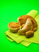 Assorted pies and pasties on paper towel