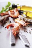 Prawns, knife, meat fork, olive oil