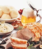 Roast pork with sauerkraut, potato dumplings & beer (Bavaria)