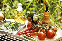 Fresh vegetables, herbs and ingredients for a barbecue