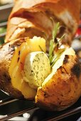 Barbecued potato with herb butter and rosemary, baguette