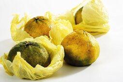 Several ugli fruits in paper