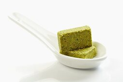 Vegetable stock cubes on spoon