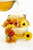 Pouring marigold tea into cup