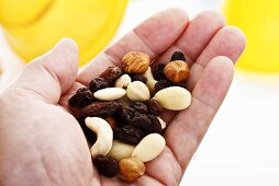 Hand holding trail mix