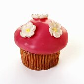 Muffin with pink icing and sugar flowers