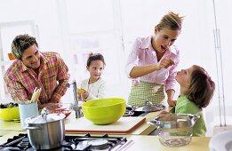 Parents with children (4-7) in kitchen