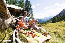 Austria, Salzburger land, parents and son (8-9) having picnic