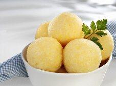Several potato dumplings in bowl