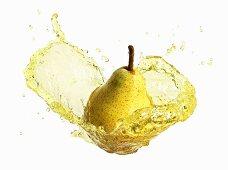 Pear with splashing pear juice