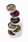 Assorted spices in small tins (stacked)