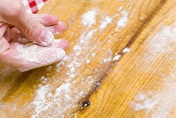 Dusting a work surface with flour