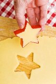 Cutting biscuits out of biscuit dough