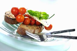 Toast with cherry tomatoes, feta cheese and basil