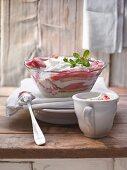 Rhubarb trifle with lemon balm, sponge and a lime and quark cream