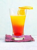Tequila Winter Sun garnished with a slice of orange