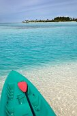 Boat with paddles on the beach of Dhigufinolhu island, Maldives