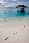 Traditional boat Dhoni in sea in Dhigufinolhu island, Maldives