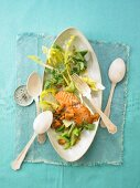 Salad with fried salmon, cucumber and chanterelle mushrooms