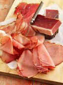Raw ham, partially sliced
